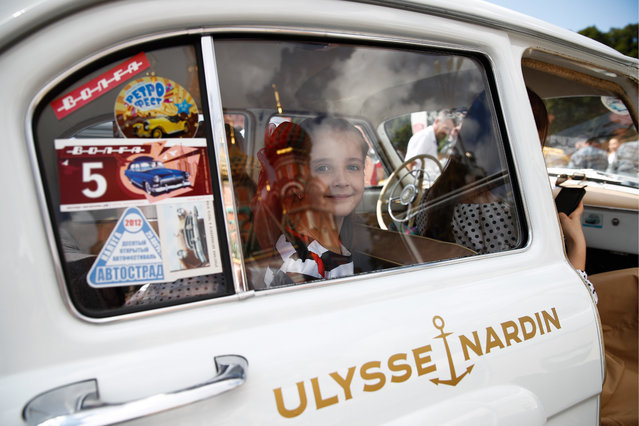 A young passenger during the 2019 GUM Motor Rally featuring classic cars in Moscow, Russia on July 28, 2019. (Photo by Artyom Geodakyan/TASS via Getty Images)