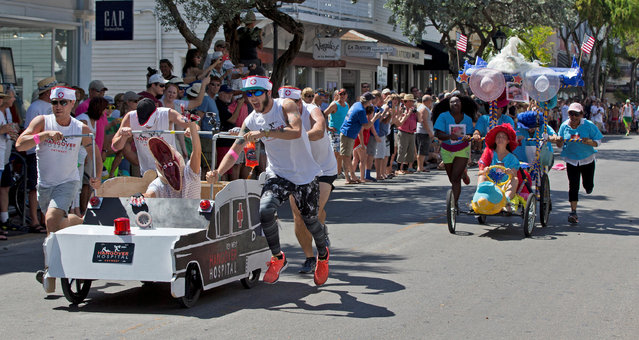 Competitors in the Conch Republic Bed Race roll up Duval Street in Key West, Florida April 30, 2016. (Photo by Rob O'Neal/Reuters/Courtesy of Florida Keys News Bureau)