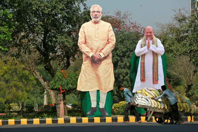 Giant cardboard cut outs of PM Narendra Modi (C) and Bharatiya Janata Party president Amit Shah are displayed in New Delhi, March 15, 2017. (Photo by Cathal McNaughton/Reuters)