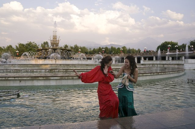 School graduates laugh while standing in a public fountain on the evening of a hot summer day in Almaty, Kazakhstan, July 3, 2015. (Photo by Shamil Zhumatov/Reuters)