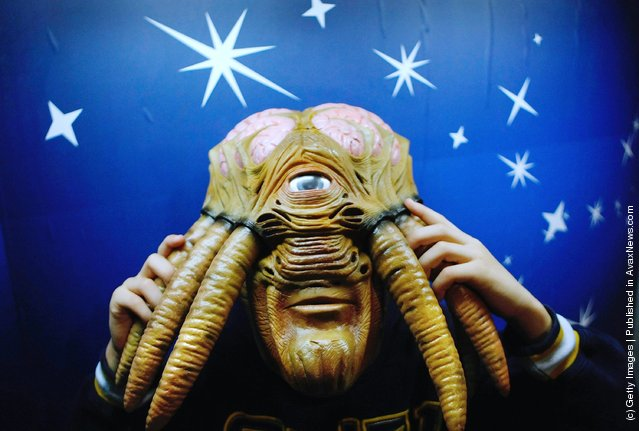 A young boy wears a Doctor Who Dalek Sec Hybrid Voice Changer Mask during the Dream Toys 2007 Christmas predictions fair
