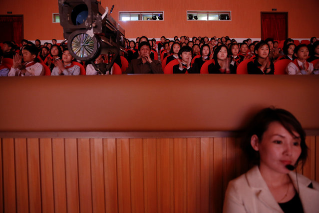 A member of staff and spectators watch a performance at the Mangyongdae Children's Palace in Pyongyang, North Korea May 5, 2016. (Photo by Damir Sagolj/Reuters)