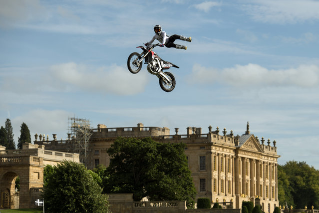 Dan Whitby of the Bolddog Lings FMX Display Team performs in the Grand Ring on the first day of the Chatsworth Country Fair in the grounds of Chatsworth House, near Bakewell in northern England on August 30, 2019. (Photo by Oli Scarff/AFP Photo)