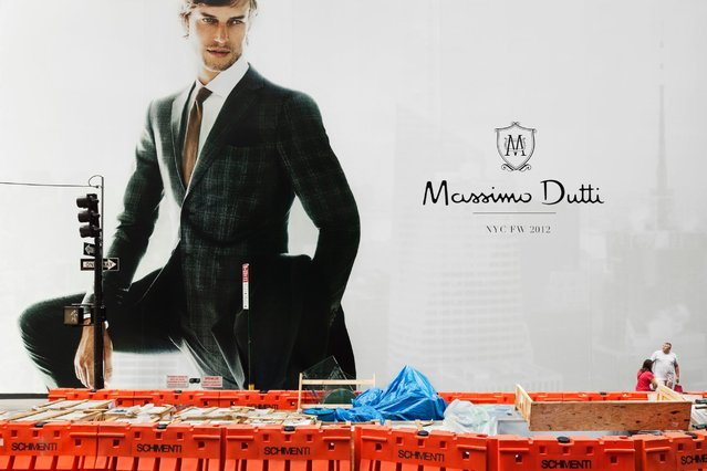 "To Dvir, ""Coming Soon"" is an exploration of our visual relationship with the branded city centers and the commercial environment we live in. Seen here, A man looks at a Massimo Dutti billboard on 54th street and 5th Avenue in New York, August 12, 2012. (Photo by Natan Dvir/Polaris)"