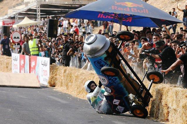 A competitor crashes while driving his homemade vehicle without an engine during the Red Bull Soapbox Race in Amman, Jordan on September 20, 2019. (Photo by Muhammad Hamed/Reuters)