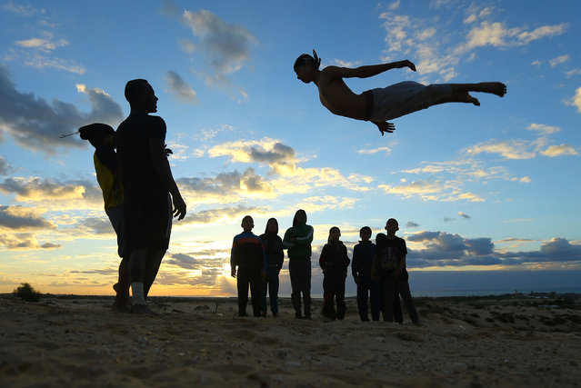 Palestinian youth show their skills on the beach in Rafah in the southern Gaza Strip, on February 17, 2017. (Photo by Mohammed Abed/AFP Photo)