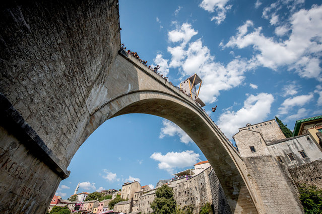 In this handout image provided by Red Bull, Genevieve Bradley of the USA dives from the 21 metre platform on Stari Most during the first training session of the sixth stop of the Red Bull Cliff Diving World Series on August 22, 2019 at Mostar, Bosnia and Herzegovina. (Photo by Romina Amato/Red Bull via Getty Images)
