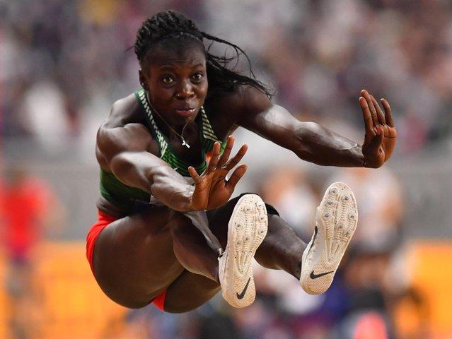 Marthe Koala of Burkina Faso competes in the Women's Heptathlon long jump during day seven of 17th IAAF World Athletics Championships Doha 2019 at Khalifa International Stadium on October 03, 2019 in Doha, Qatar. (Photo by Dylan Martinez/Reuters)
