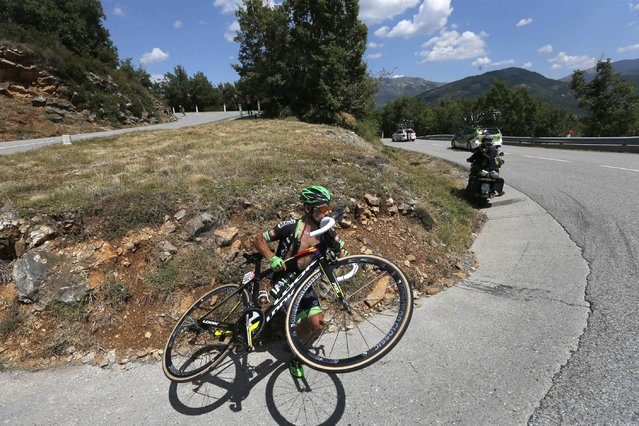 Armindo Fonseca of France gets back on the road after going straight into the grass when arriving to fast in a hairpin turn in a downhill during the seventeenth stage of the Tour de France cycling race over 161 kilometers (100 miles) with start in Digne-les-Bains and finish in Pra Loup, France, Wednesday, July 22, 2015. (Photo by Christophe Ena/AP Photo)