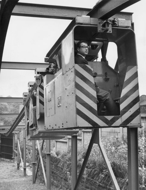 A 'Monorail Locomotive and Man Riding Carriage' devised by Qualter Hall & Co of Yorkshire for use in collieries. It is hoped that it will enable men, supplies and coal to be taken to and from the coal face more quickly, 1965
