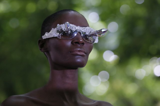 A model presents a creation by Bulgarian designers Livia Stoianova and Yassen Samouilov as part of their Haute Couture Fall/Winter 2014-2015 fashion show for fashion house On Aura Tout Vu in Paris July 7, 2014. (Photo by Gonzalo Fuentes/Reuters)