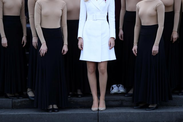 Belgium's Crown Princess Elisabeth poses with dancers and youth after a ceremony on the occasion of her 18th birthday, outside the Royal Palace in Brussels, Belgium on October 25, 2019. (Photo by Yves Herman/Reuters)
