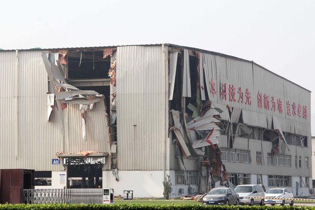 A damaged warehouse is seen at the site of a series of explosions in Tianjin on August 13, 2015. (Photo by AFP Photo)