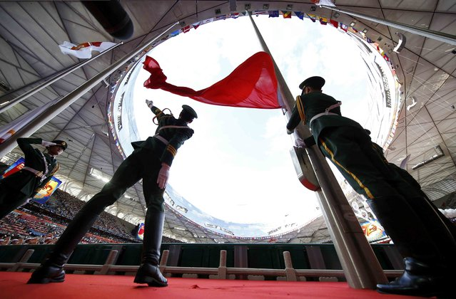 China's national flag is raised during the opening ceremony of the 15th IAAF World Championships at the National Stadium in Beijing, China August 22, 2015. (Photo by Kai Pfaffenbach/Reuters)