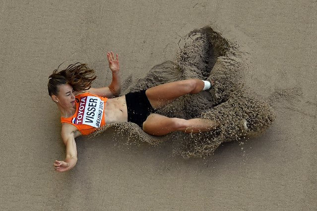 """Netherlands' Nadine Visser competes in the long jump of the women's heptathlon athletics event at the 2015 IAAF World Championships at the """"Bird's Nest"""" National Stadium in Beijing on August 23, 2015. (Photo by Antonin Thuillier/AFP Photo)"""
