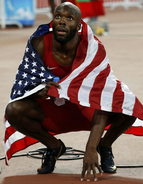 LaShawn Merritt of the U.S. looks at the scoreboard after finishing second in the men's 400 metres final during the 15th IAAF World Championships at the National Stadium in Beijing, China August 26, 2015. (Photo by David Gray/Reuters)
