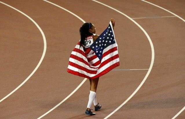 Allyson Felix of the U.S. celebrates with her national flag after winning the women's 400m final during the 15th IAAF World Championships at the National Stadium in Beijing, China, August 27, 2015. (Photo by Fabrizio Bensch/Reuters)