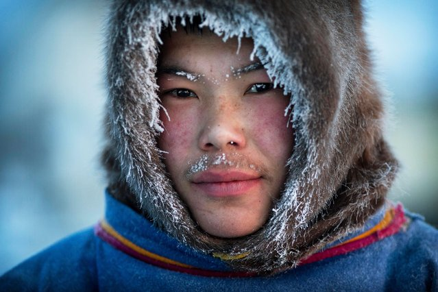 One of the members of the Nenets tribe looks to the camera in Siberia, December 2016. (Photo by Timothy Allen/Barcroft Productions)