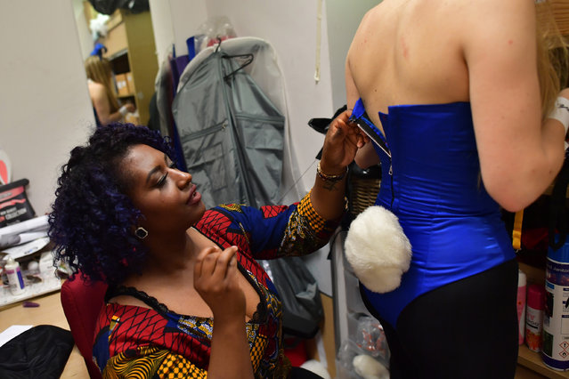 Seamstress, Feyi, adjusts a Playboy Bunny's costume as the Bunny prpares for work at the Playboy Club on July 26, 2016 in London, England. (Photo by Carl Court/Getty Images)