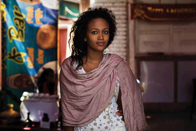 """Photographer Mihaela Noroc travelled the world from Ethiopia to the US and from Guatemala to France in search of natural and authentic beauty. She introduces some of the inspiring women she met on her journey. Here: Ethiopia. """"I met Samira in her best friend's coffee shop. She is Muslim and her friend is Christian. I saw many beautiful friendships in Ethiopia that go beyond religion. But there were also terrible conflicts, rooted in differences of ethnicity. Samira's serene look gives me hope that kindhearted people like her will make this world a better place"""". (Photo by Mihaela Noroc/The Guardian)"""