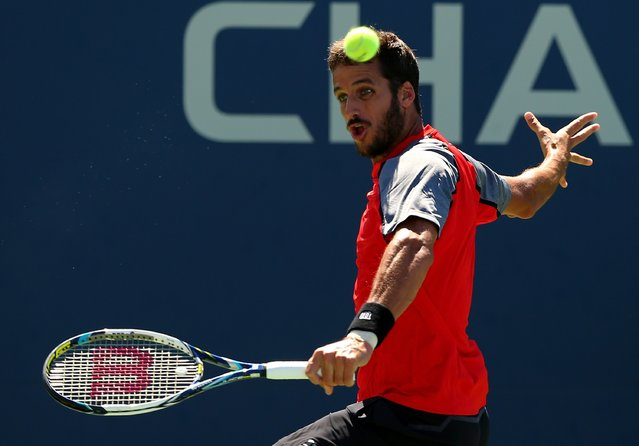 Feliciano Lopez of Spain returns a shot to Tatsuma Ito of Japan during their men's singles second round match on Day Five of the 2014 US Open at the USTA Billie Jean King National Tennis Center on August 29, 2014 in the Flushing neighborhood of the Queens borough of New York City. (Photo by Elsa/Getty Images)