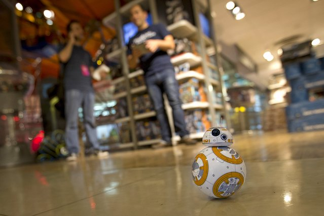 """A BB-8 remote control robot toy that went on sale at midnight in advance of the film """"Star Wars: The Force Awakens"""" in Times Square in the Manhattan borough of New York, September 4, 2015. (Photo by Carlo Allegri/Reuters)"""