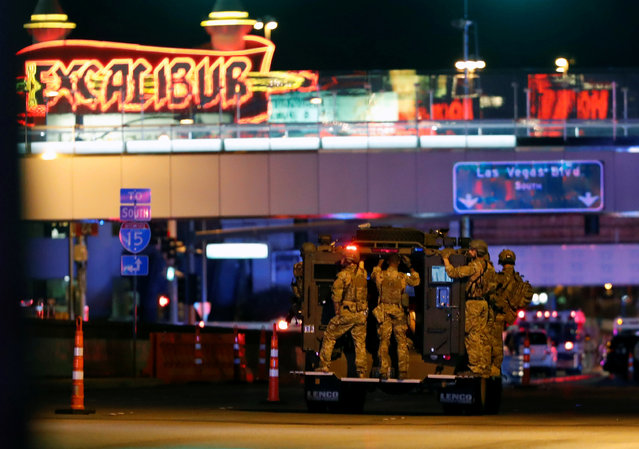 FBI agents ride an armored vehicle to a staging area on October 2, 2017, after a mass shooting at a music festival on the Las Vegas Strip in Las Vegas, Nevada on October 1, 2017. (Photo by Steve Marcus/Reuters/Las Vegas Sun)