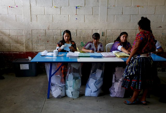 A woman waits to get his finger inked after casting her vote at a polling station during general elections in Guatemala City, September 6, 2015. Still reeling from a corruption scandal that felled their president three days ago, Guatemalans headed to the polls on Sunday to elect a new leader in a tight contest that is likely to head to a second round run-off. (Photo by Jorge Dan Lopez/Reuters)