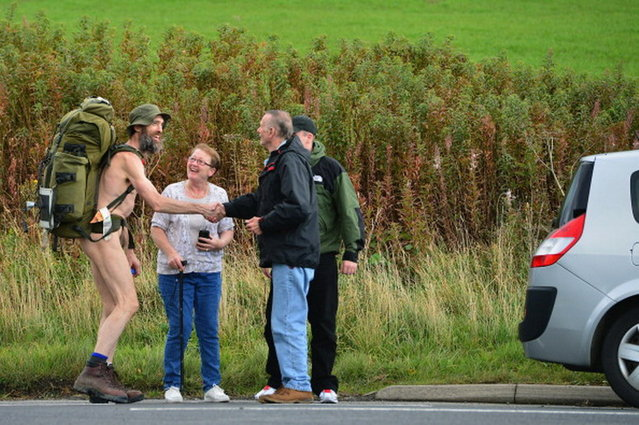Stephen Gough the naked rambler chats to people he encounters as he makes his way south through Peebles in the Scottish Borders, following his release from Saughton Prison yesterday after serving his latest sentence on October 6, 2012 in Peebles, Scotland. The rambler has 18 convictions and has been in prison on and off since 2006 with offences ranging from not wearing clothes in front of the sheriff, breach of the peace and contempt of court.  (Photo by Jeff J. Mitchell)