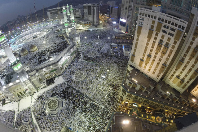 Muslim pilgrims pray around the holy Kaaba at the Grand Mosque during the annual Hajj pilgrimage in Mecca September 27, 2014. (Photo by Muhammad Hamed/Reuters)