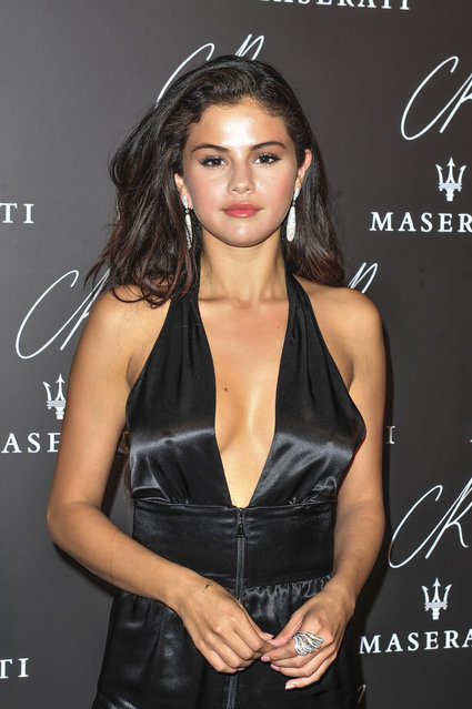 Selena Gomez poses at Carine Roitfeld & Stephen Gan celebration of the launch of CR Fashion Book N.5 in Paris, Tuesday, September 30, 2014. (Photo by Zacharie Scheurer/AP Photo)