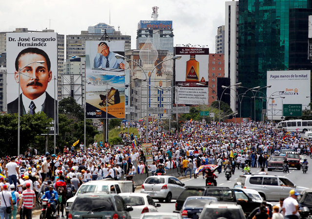 Opposition supporters take part in a rally to demand a referendum to remove Venezuela's President Nicolas Maduro, in Caracas, Venezuela, September 1, 2016. (Photo by Christian Veron/Reuters)