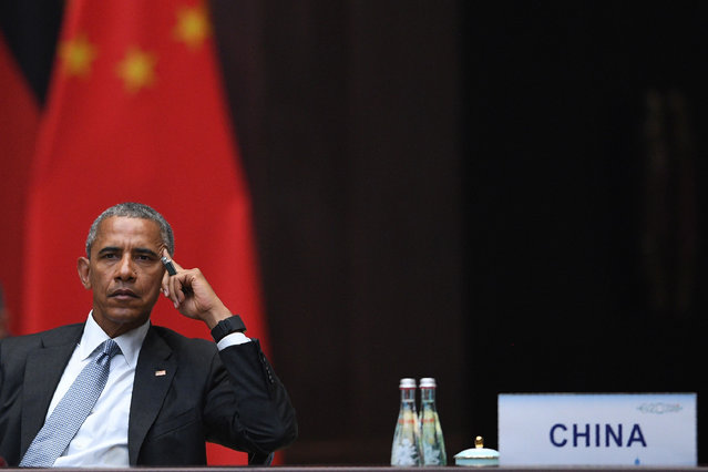 US President Barack Obama looks on during the G20 Summit in Hangzhou on September 4, 2016. World leaders are gathering in Hangzhou for the 11th G20 Leaders Summit from September 4 to 5. (Photo by Johannes Eisele/AFP Photo)