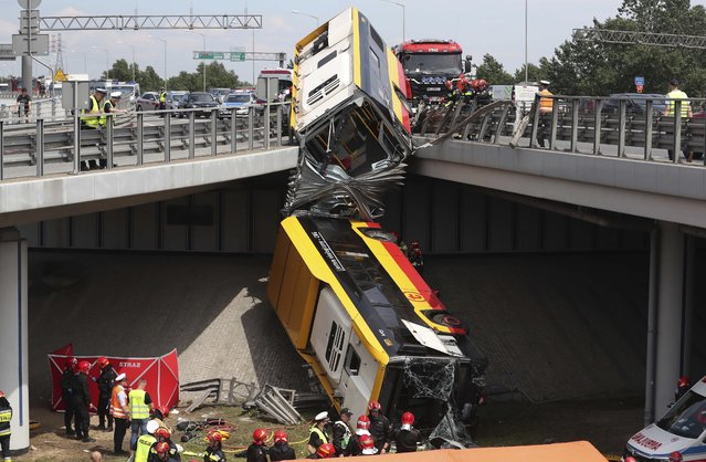 The wreckage of a Warsaw city bus is shown after the articulated bus crashed off an overpass, killing one person and injuring about 20 people, in Warsaw, Poland, on June 25, 2020. The accident forced Warsaw Mayor Rafal Trzaskowski, who is a runner-up candidate in Sunday presidential election, to suspend his campaigning. (Photo by Czarek Sokolowski/AP Photo)