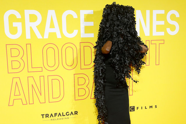 """Singer Grace Jones adjusts her hat as she arrives for the UK premiere of her movie """"Grace Jones: Bloodlight and Bami"""" in London, Britain, October 25, 2017. (Photo by Peter Nicholls/Reuters)"""