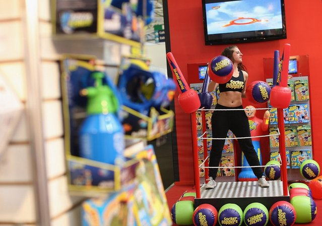 A woman works out on a trade stand during the 2013 London Toy Fair at Olympia Exhibition Centre on January 22, 2013 in London, England. The annual fair which is organised by the British Toy and Hobby Association, brings together toy manufacturers and retailers from around the world.  (Photo by Dan Kitwood)