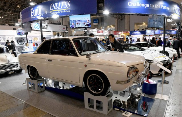 A Hino Contessa 1300 coupe is seen on display at the Ewig by Endless booth of the Tokyo Auto Salon at the Makuhari Messe in Chiba on January 12, 2018. (Photo by Toshifumi Kitamura/AFP Photo)