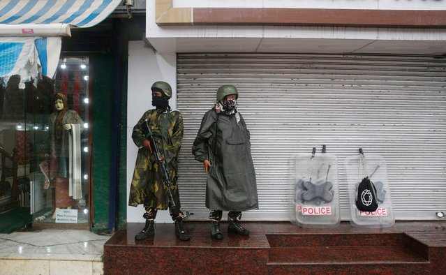 Indian paramilitary soldiers stand guard in Srinagar, the summer capital of Indian Kashmir, 27 August 2020. The Indian National Investigating Agency (NIA) on 26 August 2020 filed a charge sheet against 19 persons including the Jaish-e-Mohammad (JeM) outfit chief, Masood Azhar in the 2019 Pulwama Fidayeen on 14 February 2019, when a Jaish-e-Mohammad (JeM) militant rammed an explosive-laden vehicle into a Central Reserve Police Force (CRPF) convoy along the Srinagar-Jammu highway in Lethpora. (Photo by Farooq Khan/EPA/EFE)