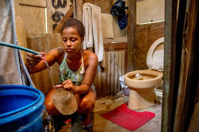 "Brazil. Lorena, 16, is a student. She has just moved into one of Rio de Janeiro's favelas. ""I don't have a toilet but I am working hard to try and build one. In the meantime, I have to use my mother's. We only get water on Thursdays and Sundays, when the taps are opened. One day I would like to have a bathroom with running water. I am very vain, I like to have my hair and nails done and use perfume. Some people around here have been in poor health, partly due to the poor sanitation situation in the area"". (Photo by Eduardo Martino/WSUP/Panos)"