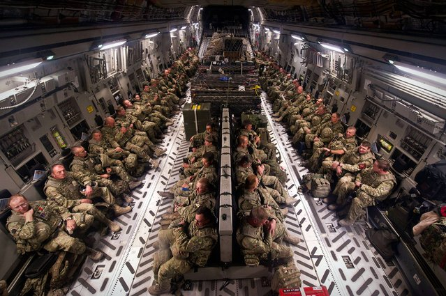 Undated handout photo issued by the MoD of British military personnel in southern Afghanistan sitting patiently onboard a RAF C17 destined for the UK. The final UK service personnel left Kandahar Airfield in southern Afghanistan after completing the military redeployment operation. (Photo by Corporal Andrew Morris (RAF)/MoD Crown Copyright/PA Wire)
