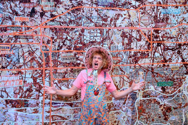 """British artist Grayson Perry poses in front of """"Very Large Very Expensive Abstract Painting"""", which forms part of an exhibition of new work based on recent travels in the U.S., at the Victoria Miro gallery, London, Britain, September 14, 2020. (Photo by Toby Melville/Reuters)"""
