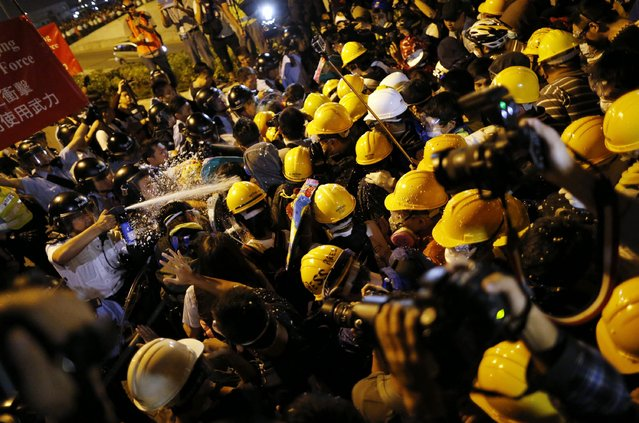 Police use pepper spray during clashes with pro-democracy protesters close to the chief executive office in Hong Kong, November 30, 2014. (Photo by Tyrone Siu/Reuters)