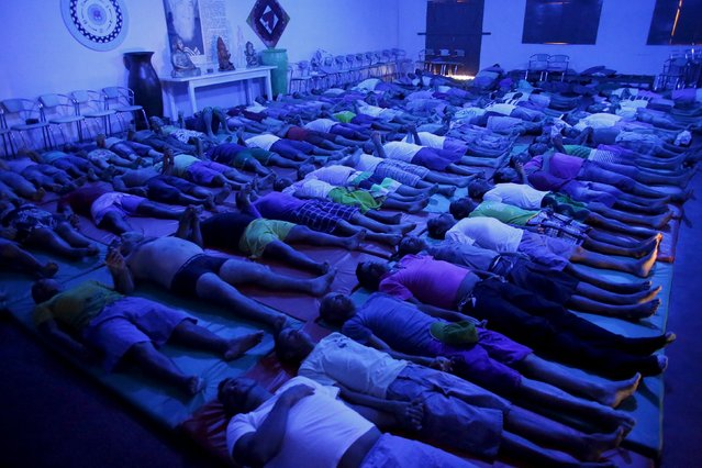 Inmates do yoga stretches and breathing exercises as part of the ACUDA programme, at a complex of ten prisons in Porto Velho, Rondonia State, Brazil, August 28, 2015. (Photo by Nacho Doce/Reuters)