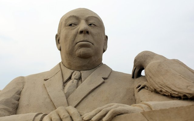 Detail of a sand sculpture of Alfred Hitchcock is seen as pieces are prepared as part of this year's Hollywood themed annual Weston-super-Mare Sand Sculpture festival on March 26, 2013 in Weston-Super-Mare, England. Due to open on Good Friday, currently twenty award winning sand sculptors from across the globe are working to create sand sculptures including Harry Potter, Marilyn Monroe and characters from the Star Wars films as part of the town's very own movie themed festival on the beach.  (Photo by Matt Cardy)