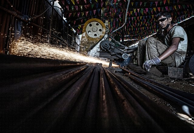 """Domestic migrant worker Sushil Gupta performs welding work at a factory, ahead of the Nepalese festivals Dashain, Dipawoli and Chath; in Kathmandu, Nepal, 13 October 2020. """"I am facing huge financial crisis due to the long period of pandemic lockdown. Now, government eased the lockdown so I will not be going home to celebrate upcoming biggest festivals with my family. I have to work here"""", said Suhil. (Photo by /EPA/EFE)Narendra Shrestha"""