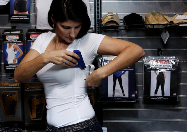 A model from The Well Armed Woman demonstrates Concealment Under Shirt in Ghent, New York, U.S., October 5, 2016. Picture taken October 5, 2016. (Photo by Brendan McDermid/Reuters)