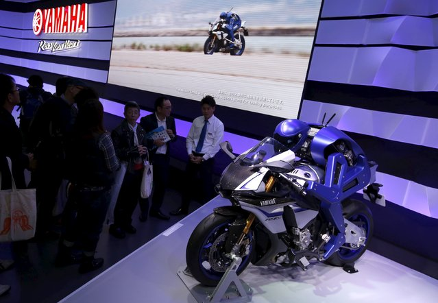 Yamaha Motor Co Ltd's displays the company's prototype model of a motorcycle riding robot 'MOTOBOT Ver. 1' at the 44th Tokyo Motor Show in Tokyo, Japan, November 2, 2015. (Photo by Issei Kato/Reuters)