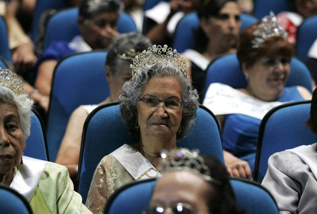 """Elderly women wearing tiaras sit in the audience during a beauty pageant for elderly women called the """"Queen of the Elderly"""" in Guadalajara, Mexico, on April 17, 2013. Eight contestants, ranging in age from 65-75, answered questions about their lives and what it means to be a senior citizen in today's society, as they competed in the annual event to win the top prize of a handbag and jewellery creations by local designers. (Photo by Alejandro Acosta/Reuters)"""