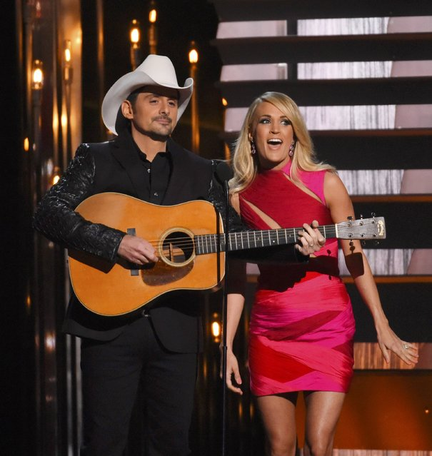 Show hosts Brad Paisley and Carrie Underwood perform at the 49th Annual Country Music Association Awards in Nashville, Tennessee November 4, 2015. (Photo by Harrison McClary/Reuters)