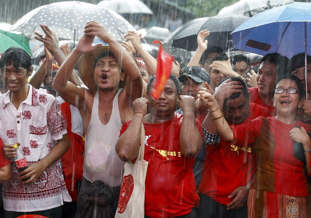 Supporters celebrate as they wait for official results from the Union Election Commission in front of National League for Democracy Party (NLD) head office at Yangon, November 9, 2015. (Photo by Soe Zeya Tun/Reuters)